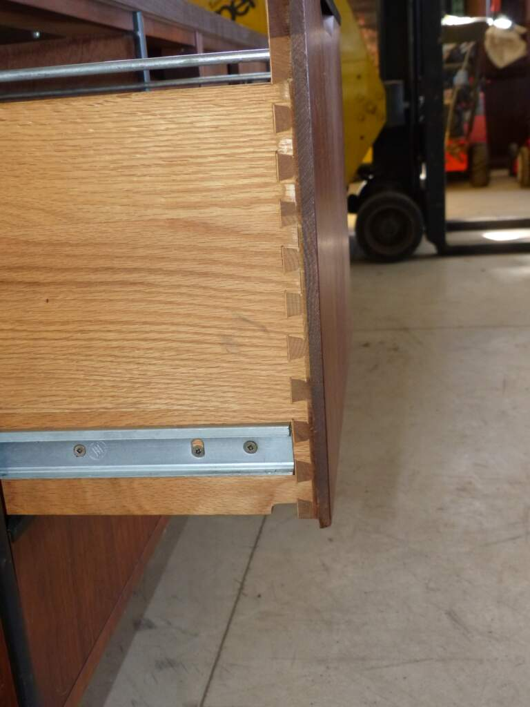 These dovetail joints were common back in the day and used to hold furniture together instead of nails or screws. They are sturdy and a sign the person who made your furniture took the time to do a good job.